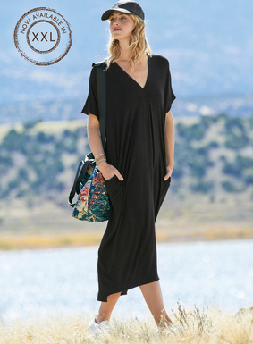 Cool and minimal, the contemporary caftan is year-round fabulous in fluid viscose (95%) and spandex (5%) jersey. The fit is effortlessly relaxed, with a double v-neck, dolman sleeves and a curved, back-dipping hemline; pockets.