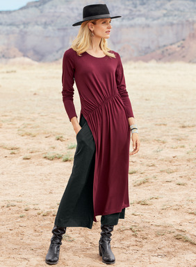 The contemporary viscose (92%) and spandex (8%) jersey tunic, with an asymmetrical shirred waist that releases to an angled side-slit hem.