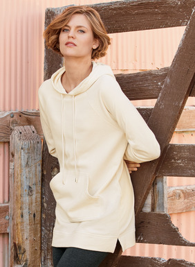 Our luxe take on the sporty sweatshirt is cut long and lean in sublimely soft French terry. The classic cotton pullover has a drawstring hood, raglan sleeves, kangaroo pocket and side-slit hem.