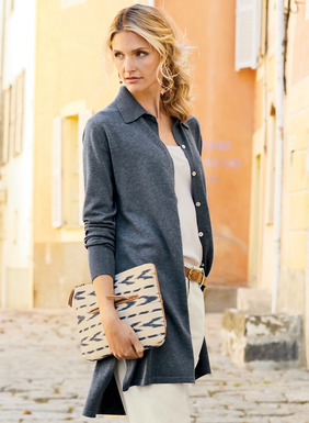 A wardrobe cornerstone, the cardigan can be worn buttoned as a tunic or open and easy as a relaxed shirt-jacket. Full-fashion, fine gauge knit of pima, with ribbed cuffs, back-stepped hem and side vents.