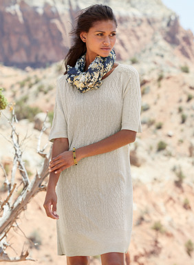 Effortless sweater-dressing, the pima tunic-dress mixes columns of Aran cables and bas-relief lattice work. The straight-falling, full-fashion knit dress has raglan elbow sleeves, jersey side panels and ribbed trim.