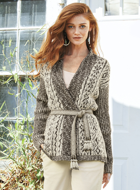 A textural mix of bas-relief cables, the cardigan is knit of lofty pima bouclé yarns in a palette of tweeded neutrals. Styled with drop shoulders, ribbed sleeves and a rolled-edge shawl collar. Wonderful worn as a drapy, straight-falling cardigan or wrapped at the waist, as shown.