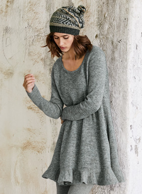 Adorable one-step dressing, the light-as-air tunic is full-fashion knit of frothy, Heather Grey baby alpaca (60%), nylon (35%) and merino wool (5%). Perfect over our Heather Grey Spa Leggings, the easy trapeze shape is finished with a scooped neck and flirty flounced hem.