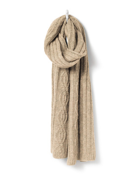 Textured in chunky ribs and cables, the scarf is knit in an ultra-soft tweed of baby alpaca (60%), nylon (35%) and merino wool (5%).