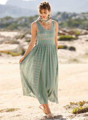 Undulating stripes of soft seafoam and sand float effortlessly through the spring days. Fine gauge knit of pima (80%) and modal (20%) yarns, our gossamer tank dress fits through the bodice and flares at the seamed waist to a full pleated skirt.