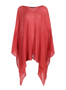 A gossamer layer that's dramatic over leggings, dresses or on the beach, our poncho-style pullover is knit of feather-light baby alpaca (60%), nylon (35%) and merino wool (5%). With a bateau neck and armholes, it floats to a breezy handkerchief hem.