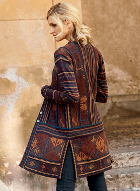 An intriguing piece with global-chic appeal, the long v-neck cardigan is a patchwork of elaborate geometrics from an Anatolian kilim. Jacquard knit in Turkish rug hues of henna, spice, amethyst, copper and indigo pima, with contrast banding and deep side slits.