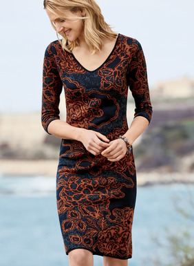 Coppery Asian florals drift across the dappled navy and dusky blue ground of the pima cocktail sheath. A sophisticated silhouette with day-to-night potential, it's jacquard knit with a double v-neck, elbow-length sleeves and a flattering knee-length hem.