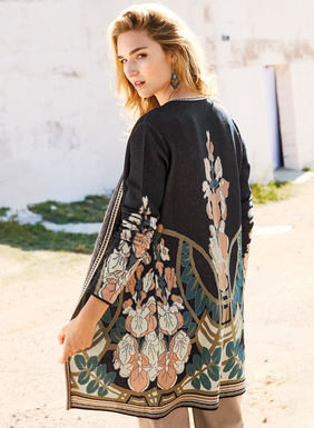 Art Nouveau wisteria and decorative linework are resplendant on the textural, navy pima ground. A gorgeous statement piece, jacquard knit with contrast striping at the buttonless placket and hem.