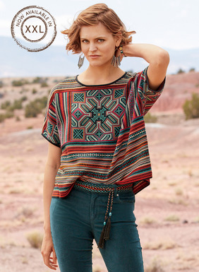 Relaxed, boxy and great with flowy skirts and skinny jeans alike, the jacquard knit top echoes a cross-stitched antique textile in brilliant magenta, teal, orange, navy and sand pima. Styled with a round neck and short dolman sleeves.