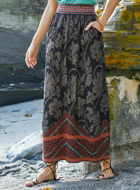 Damask florals and Polynesian bark cloth motifs combine on our long, pima A-line skirt. Jacquard knit in black, taupe, terra cotta and teal. Gathered waist; pockets; ankle-grazing hem.