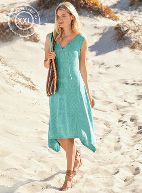 Our breezy dress is jacquard knit in tone-on-tone hues of aqua pima (77%) and modal (23%). Split v-neck; tassels; side-draping hem.