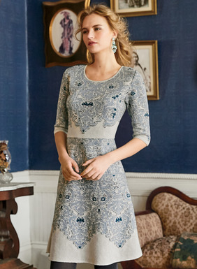 Our heart-stirring dress is strategically patterned in baroque scrolls inspired by an Algerian embroidered textile. Jacquard knit in chambray and navy on cream pima (95%), with shimmering silver metallic (5%) threads. The fit-and-flare shape has a round neck, elbow sleeves and a defined waist seam.