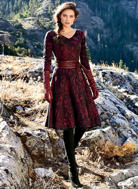 Brocade blooms are jacquard knit in wine red and black pima (83%) and lit with copper metallic (17%) threads. Knit in engineered gores, the dress fits slim through the bodice and flares to a twirlable hem. Double v-neck; ¾-sleeves; contrast binding.