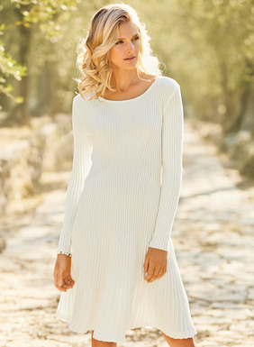 Sophisticated day-into-evening chic, the masterfully engineered, fine gauge knit dress is fresh for spring in soft, snow-hued pima. Strategically traced with sculptural ribs for a flawless, fit-and-flare shape.