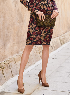Florals echoing a Moroccan tile pattern a classic jacquard knit pencil skirt.  Pima (98%) and spandex (2%) pair with the matching jacket for a polished ensemble.