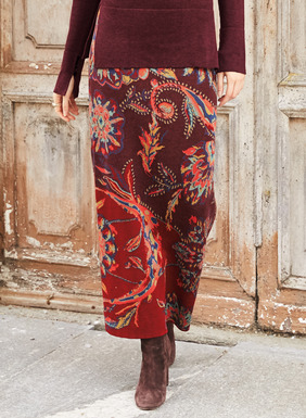 Our column, ankle length skirt was inspired by Moroccan floor tiles, grand-scale blooms illustrate the red and plum colorblocked ground. Jacquard knit of mercerized pima.