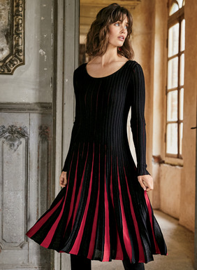 A masterful blend of craftsmanship and ingenuity, our elegant cocktail dress is engineered to fit through the ribbed bodice and ease to a twirlable hem in alternating gores of red, black and shimmery black metallic threads. Fine gauge knit of pima (95%) and metallic threads (5%).