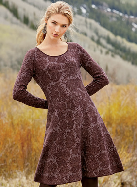 A textural brocade patterns our jacquard knit, scoop neck dress in rich hues of wine and burnt copper pima. Pure figure flattery, it's engineered to fit and flare to a sculptural hemline.