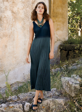 Day to date-night chic, our minimalist column dress is uniquely engineered in dimensional, plaited ribs of pima. The color shifts from navy to cerulean at the raised waist. Scoop neck; tank straps.
