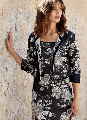 Fabulous for warm-weather celebrations paired with its matching dress. Featuring a round neck, a single hook-and-eye closure and ¾-sleeves, the jacket is also chic casually when paired with jeans and a tee.