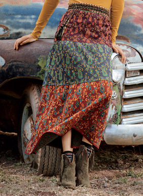 Strewn with Kashmiri paisleys and florals, the jacquard knit skirt is constructed in three color-blocked tiers. Graphically gorgeous in spicy shades of olive, plum, curry, denim and crimson pima, it flows to an A-line hem.