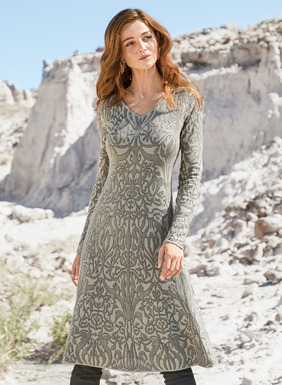 Baroque scrollwork traces the textural pima jacquard knit dress in tonal shades of taupe and stone. Beautifully engineered to fit through the v-neck bodice, this perfect all-occasion dress flares gracefully to a knee-length hem.