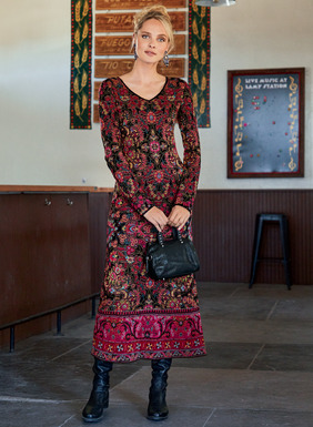 Balinese florals in a palette of vivid jewel tones on black pattern this pima jacquard knit dress. Day-to-evening chic, it's detailed with a v-neck and contrast border at the boot-length, A-line hem.