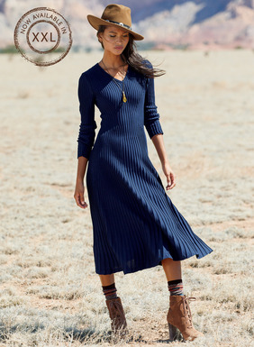 Our rich sapphire pima dress is both timeless and of the moment. Masterfully knit in sculptural hourglass ribs to trace curves without cling, it's shaped through the bodice and flares to a sweeping, boot-length hem. V-neck; slim, full-length sleeves.