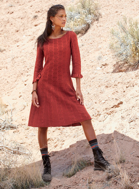 A red-hot alternative to the LBD, our pima cocktail dress is engineered in textural columns of lacy chevrons. Detailed with ¾-sleeves and ruffled cuffs, contrast patterned godets at the waist ease to a twirlable hem.