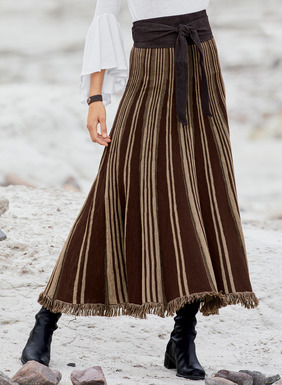 Patterned with merlot and beige stripes, the intriguing maxi-skirt in baby alpaca (70%) and silk (30%) is engineer knit in gores that flare to a dramatically sweeping fringed hem.
