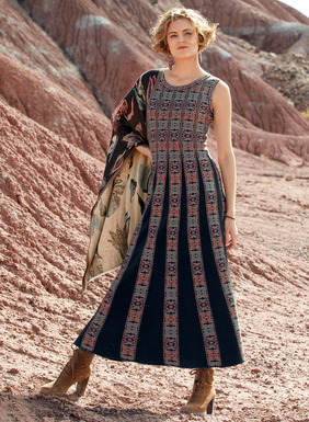 Folk art geometrics pattern our fit-and-flare sleeveless dress in chambray, burnt orange and plum pima. Superbly engineered with navy links knit gores that release to a sweeping, boot-length hem. Styled with a round neck and contrast pattern trim.