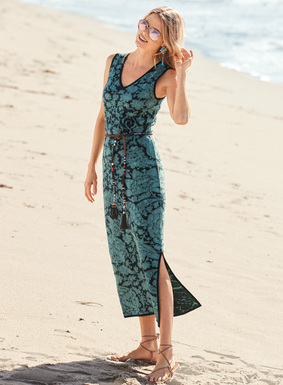 Brocade-inspired florals twine across the long, slinky column dress in plaited navy and aqua pima yarns. Chic and minimal, it beguiles with a double v-neck, contoured tank straps and a single deep side slit.
