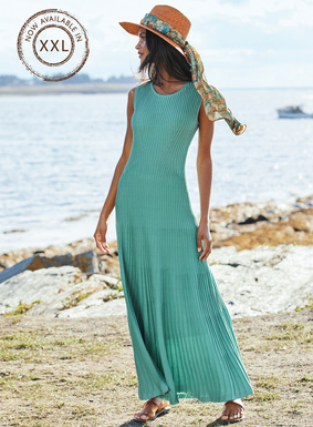 This beguiling design is masterfully engineered in architectural ribs that trace the body's curves–from the high, modern neckline and angled shaping at the waist to the sweeping, ankle-length hem. Knit of silky mercerized Aquamarine pima; also in Black.
