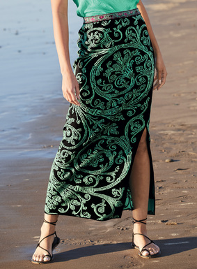Mint green botanicals scroll across the black ground of the pima jacquard skirt. Beautifully finished with a colorful contrast waistband and single deep side slit.