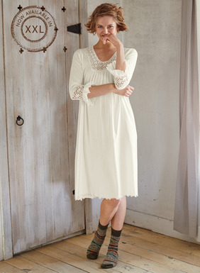 Our dreamy Ivory nightgown of silky pima jersey is lavished with handcrocheted floral insets at the neckline and ruffled ¾-sleeves. Lettuce-edged hem.