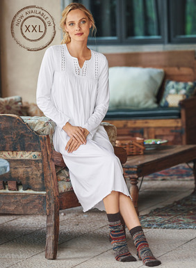 Columns of smocking and handcrocheted flowers grace the bodice of our pristine White nightgown. Silky soft in pima jersey, with a split v-neck and lettuce-edged sleeves and hem.