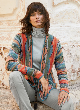 This brilliant, collectible cardigan from Kaffe Fassett features columns of chevrons and painterly stripes in dozens of hand-tweeded hues—from cool greens and blues to warm blush and coral. Intarsia knit by hand in a textural mix of mercerized and bouclé pima yarns with drop shoulders, a buttonless placket and handcrocheted trim.