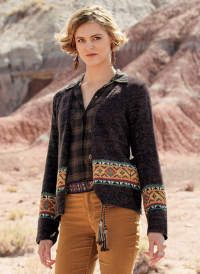 A patterned band of intarsia knit geometrics enlivens the dark tweeded ground of our pima (92%) and nylon (8%) cardigan. Masterfully handknit of mercerized and bouclé yarns for texture, with a deep v-neck and handcrocheted trim.