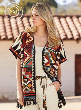The art knit cardigan is striking in southwestern geometrics of shimmery pima, textured with tweeded bouclé yarns. Buttonless placket; tassel-trimmed hem.