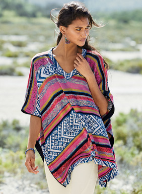From beach cabana to cocktails, this striking pima poncho is banded in tweeded jersey stripes, jacquard knit geometrics and pointelle openwork. Fresh for the season, in cheerful shades of magenta, tile blue, white, navy and brass, it has a v-neck, open sides and contrast trim.