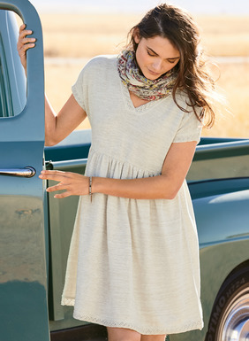 Carefree for summer days, our floaty dress is trimmed with knitted pointelle lace at the v-neck, short dolman sleeves and hem. Fine gauge knit in subtly tweeded pima yarns, with a raised waist seam and gently gathered skirt; pockets.