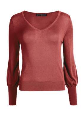Both practical and pretty, a top to own in every color. Fine gauge knit of feather-light pima (51%) and modal (49%), with a deep v-neck, blouson sleeves and exaggerated ribbed trim at the cuffs and hem.