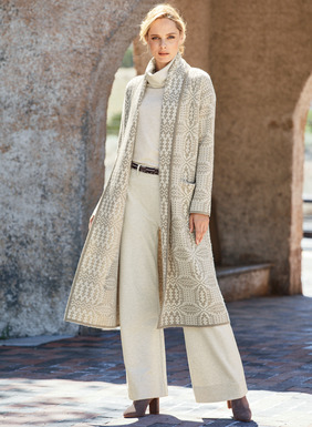 Our blanket coat is patterned after a traditional Welsh blanket in tonal ivory and wheat. Double jacquard knit and felted of baby alpaca (70%) and wool (30%), with a shawl collar, drop shoulders and patch pockets.