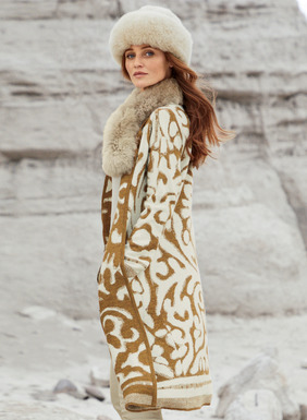 Tendrils and vines in curry and cream create a grand scale filigree on this stunning knit coat. Double-faced, felted jacquard knit of cozy baby alpaca (70%) and wool (30%), with a round neckline, buttonless placket, patch pockets and striped trim at the cuffs and hem.