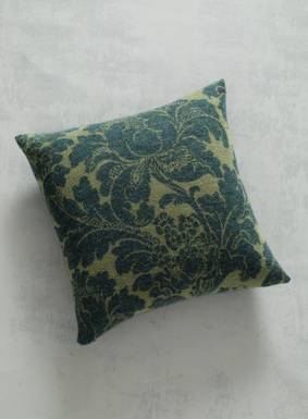 A leafy botanical in forest green and olive patterns this deliciously soft felted pillow. A layer of luxury for sofa or bed, jacquard knit of baby alpaca (70%) and wool (30%), with banded edges and  zip closure.
