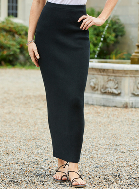 Year-round useful, the skirt is fine gauge knit in ribs for a fit that  flatters the body's curves without cling.