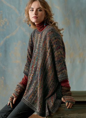 Knit in subtle columns of color, the oversized top is a textural knit in intriguing handpainted yarns of alpaca (88%) and wool (12% ). Grounded in charcoal, the style is loose and easy, with dropped sleeve openings and side vents.