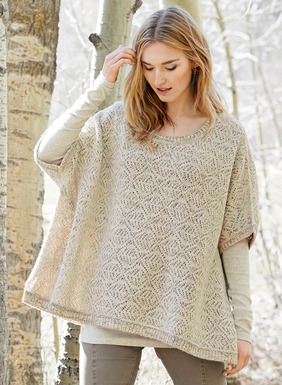 The poncho-inspired shape is knit in a lacy trellis that reverses from cream to handpainted dusty pastel yarns. Scoop neckline; drop sleeve openings; side vents.
