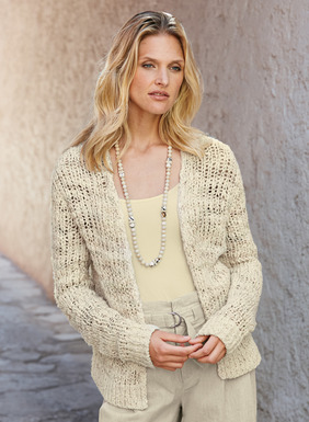 Our frothy cardigan is loosely knit of chunky white cotton yarns mixed with thin, hand-painted threads for sunbleached color accents. Buttonless placket, ribbed trim and side vents.